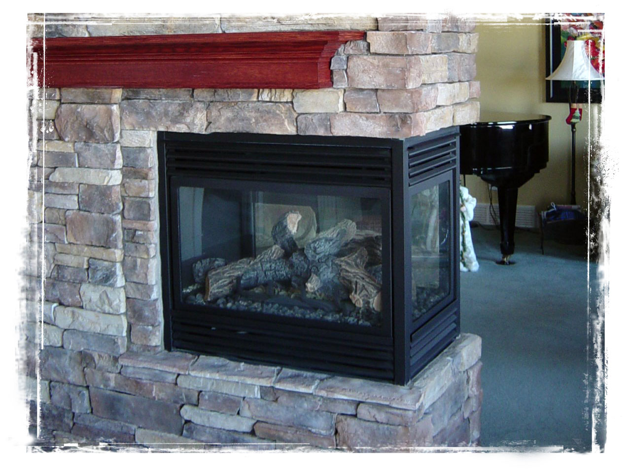 3 sided gas fireplace by Masters Group